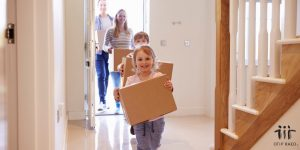 children carrying boxes