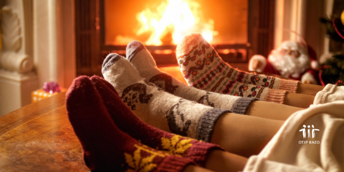 warming socks by fire