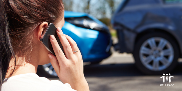 person calling insurance on cellphone